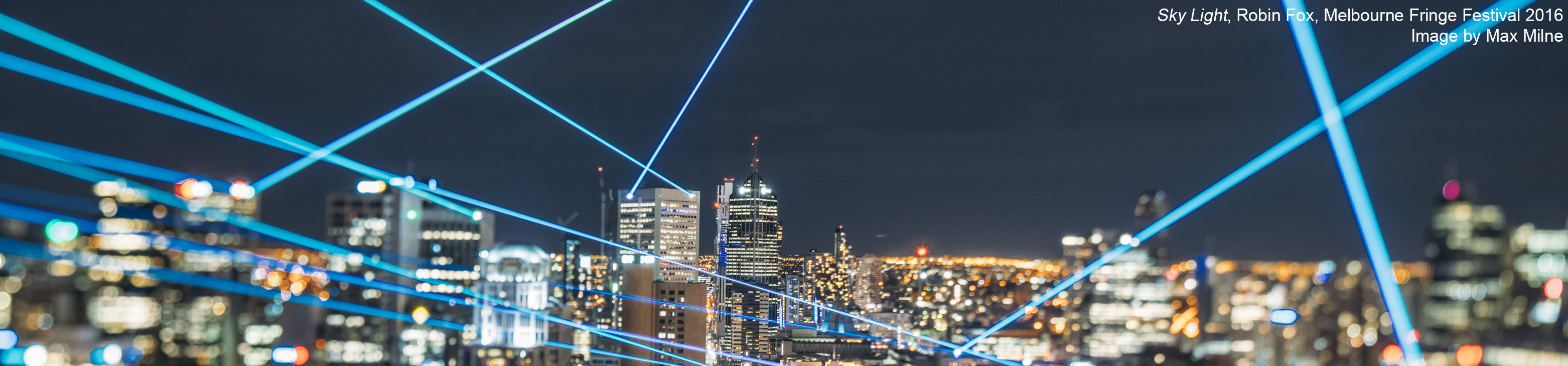 Blue laser beams shoot randomly between the tops of buildings in the night-time skyline of Melbourne's CBD