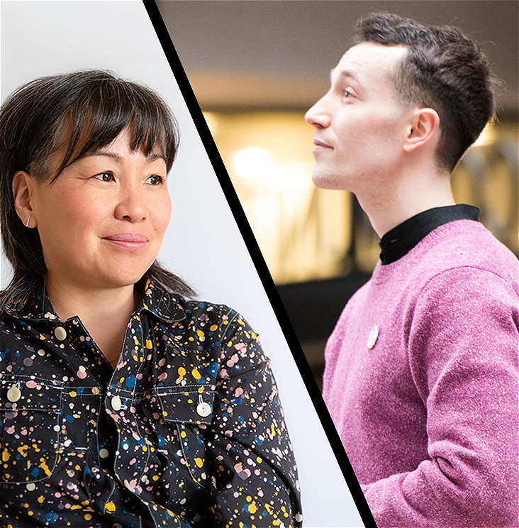 A composite image featuring two people divided by a diagonal black line. The woman on the left has short black hair, she is sitting in front of a plain grey wall and is wearing a paint splattered black denim jacket, she is looking out to the distance. The man on the right has short dark hair and is in profile, he is looking ahead and wearing a fuchsia jumper. The background is out of focus.