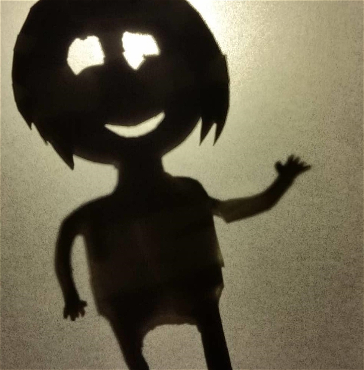 A shadow puppet depicting a child in primary school.