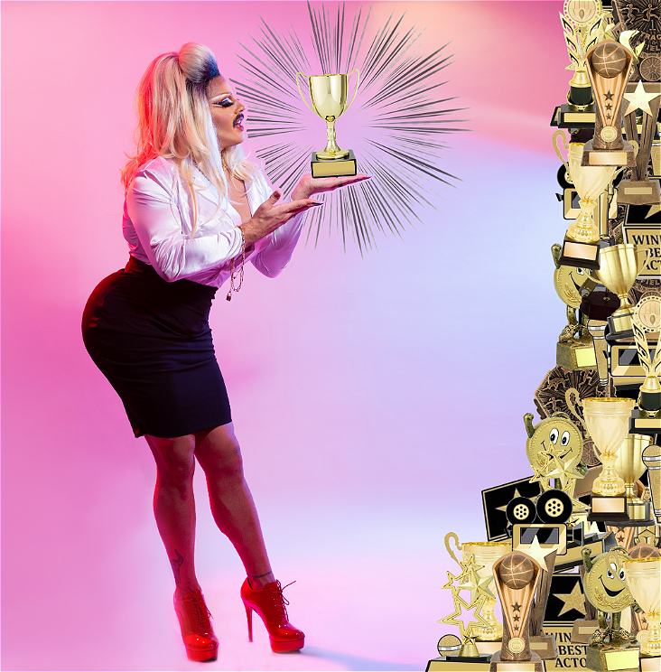 Image of Chlamydia Clementine, a Melbourne based drag Queen, in a white blouse and black skirt, holding a trophy