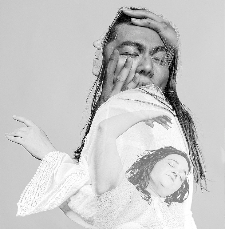 Images of 3 people in a gentle monochrome overlay. They are embedded onto a profile of a long dark haired person . Their Arms and hands are in various embraces, eyes are softly closed and faces drawing upon the light.