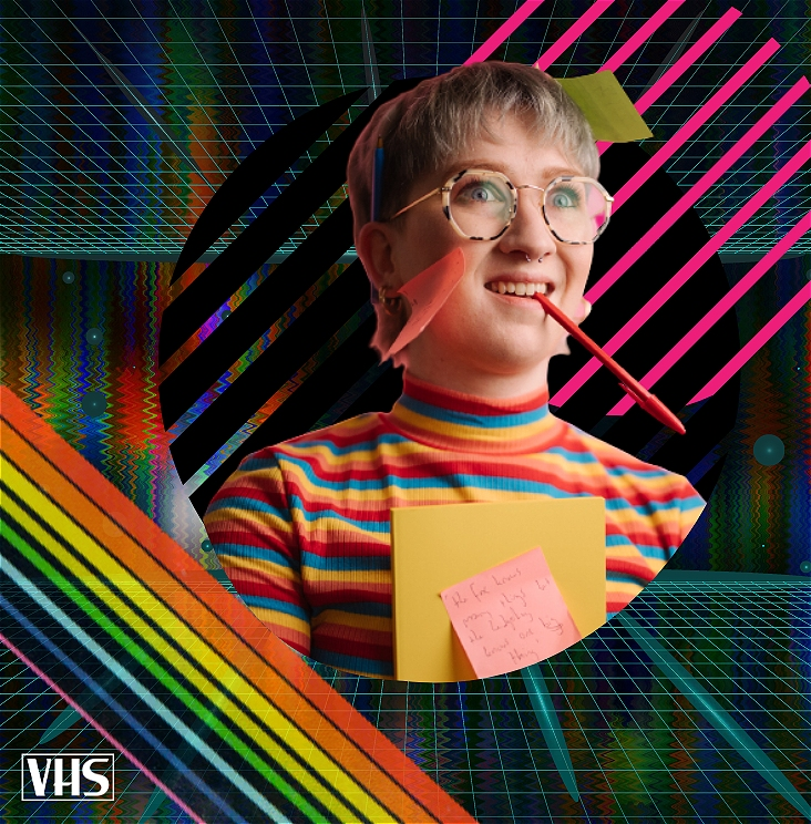 Eddie's head floats in a sea of psychedelic VHS effects, including a matrix-style grid and a rainbow streak. With a pen in their mouth and post-it-notes stuck all over them, Eddie has a crazed, manic look on their face. There is a VHS logo in the corner.