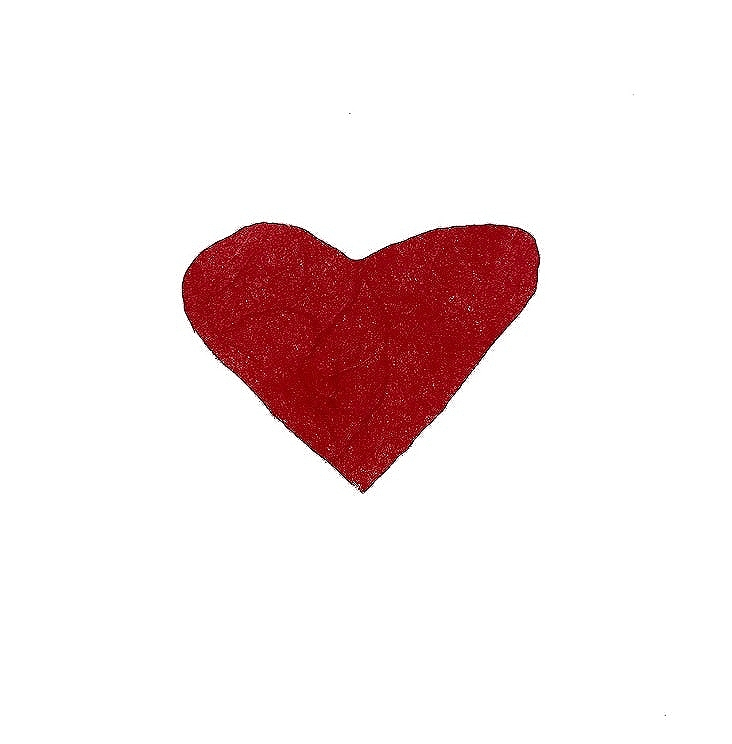 A red, paper cut-out heart on a white background.
