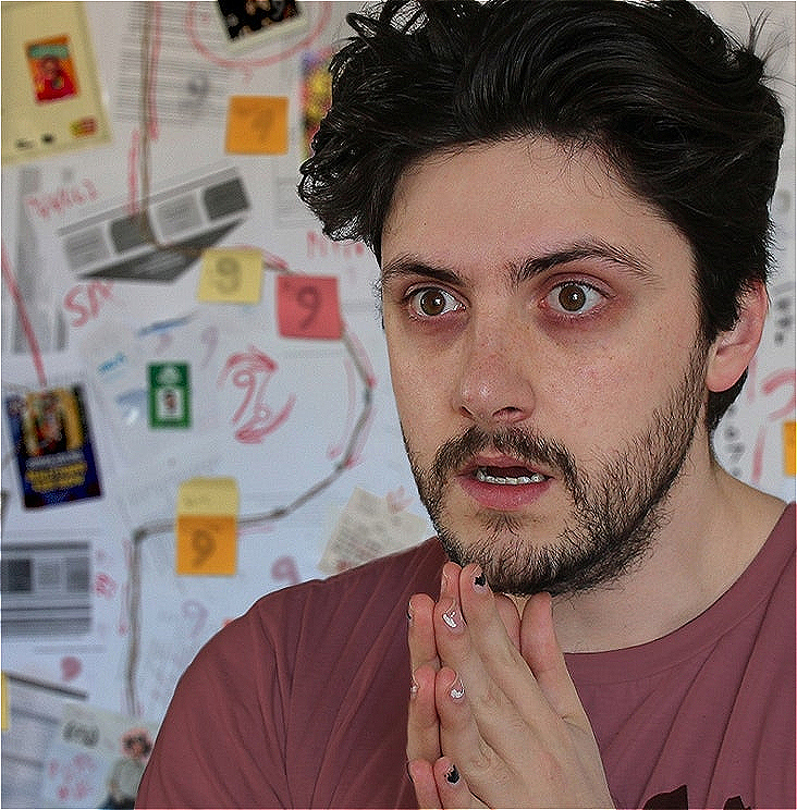 Patrick, a fair-skinned person with dishevelled dark hair, stands eyes-wide and staring blankly into the distance, looking like they haven't slept in weeks. Behind them, chaotically assembled on the wall, is an array of sticky notes, documents and photographs adorned with bizzare scrawlings. The symbol for the number nine recurs prominently in this conspiratorial diagram.