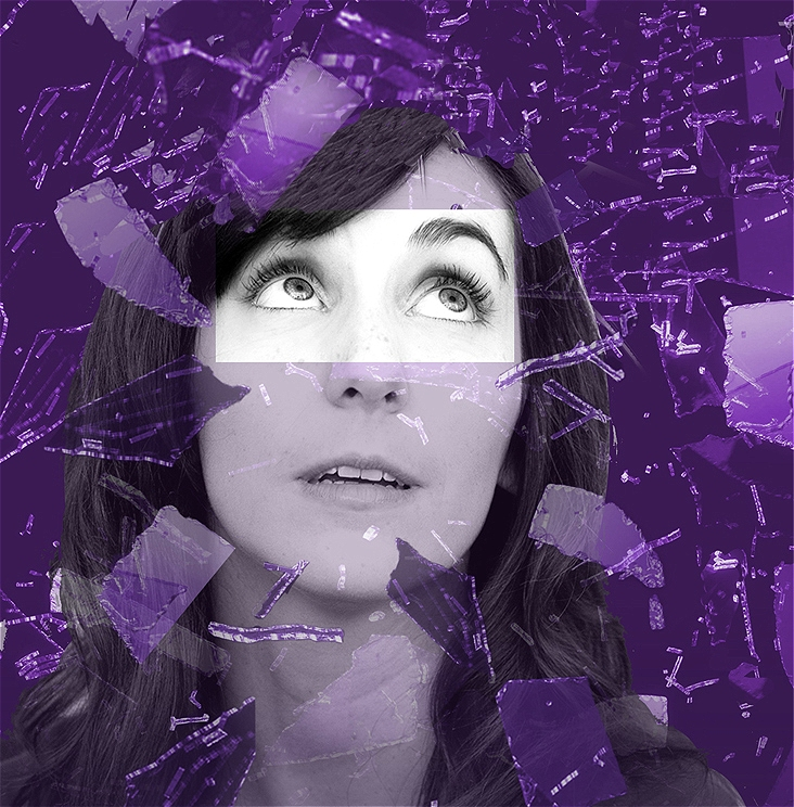 A close-up black and white image of a woman's face, with eyes looking up and to the right, laid upon a deep purple background with shards of purple glass coming out of towards the viewer.